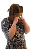 Girl Crying. A young girl crying, isolated against a white background Stock Image