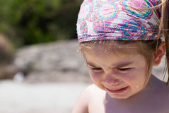 Girl crying on beach Royalty Free Stock Image
