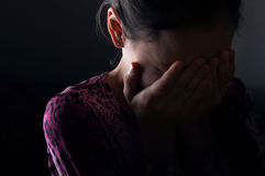 Girl crying in the darkness Stock Photo