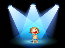 A girl crying in the middle of the stage with spotlights Stock Image