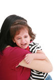 Girl crying in mothers arm Stock Photography