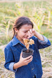 Girl crying over dead tree Stock Photography