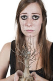 Girl crying over dead tree Royalty Free Stock Photos