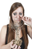 Girl crying over dead tree Stock Photos