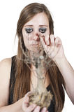 Girl crying over dead tree royalty free stock photography