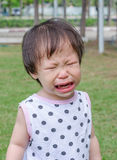 Girl crying in park Stock Image