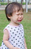 Girl crying in park Royalty Free Stock Images