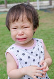 Girl crying in park Royalty Free Stock Photo