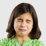 Girl crying. Portrait of a little girl making a sad expression and crying Royalty Free Stock Photography