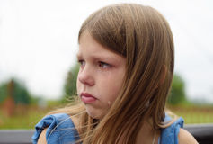 Girl crying with tears in park stock images