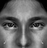 Girl Crying with Tears. Portrait of girl crying with tears rolling down her cheeks Royalty Free Stock Photo