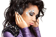 Girl with crystals on the face. Mulatto girl with crystals on the face Stock Photo