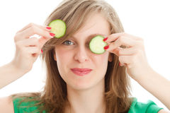 Girl with a cucumber. Woman with slice of cucumbers in her eyes Royalty Free Stock Photos
