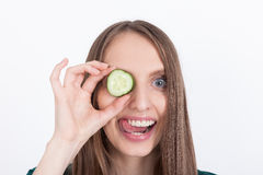 Girl with cucumber eye patch Stock Images