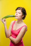 Girl with cucumber Stock Image