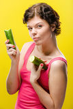 Girl with cucumber Stock Photography