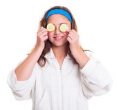 Girl with cucumber slices over her eyes Royalty Free Stock Photography