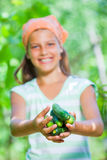 Girl with cucumbers Stock Photography