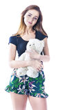 Girl with cuddly toy. Cute young woman with her favorite cuddly teddy bear Royalty Free Stock Photos