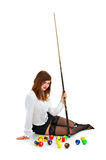 Girl with cue and billiard ball Stock Image