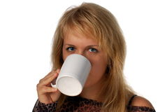 Girl with cup. Girl drinking from white cup Stock Photos
