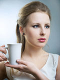 Girl with cup Royalty Free Stock Photography