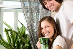 Girl with cup and boy with smile Stock Photos