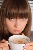 Girl with a cup of cappuccino Stock Image