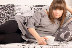 Girl with a cup of cappuccino Royalty Free Stock Image