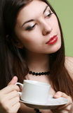 The girl with a cup of coffee. Royalty Free Stock Photo