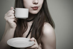 The girl with a cup of coffee. Royalty Free Stock Photos