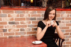 Girl with cup of coffee Royalty Free Stock Images