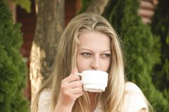 Girl with a cup of coffee. Beautiful girl with a cup of coffee stock images