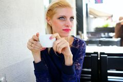 Girl with a cup of coffee Royalty Free Stock Photos
