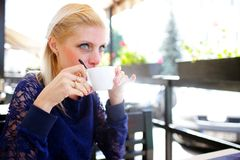 Girl with a cup of coffee Stock Photos