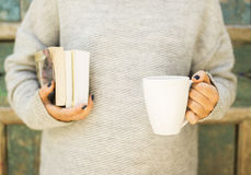 Girl with a cup of coffee and books Royalty Free Stock Photography
