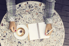 Girl with cup of coffee and diary Stock Image