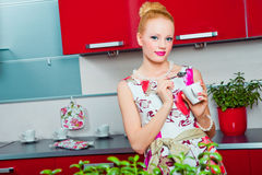 Girl with cup of coffee in interior of kitchen Stock Photography