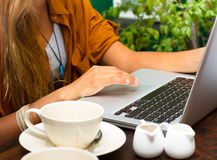 Hands typing on laptop keyboard. Women Hands typing on laptop keyboard with coffee stock images