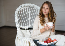 Girl with cup of coffee Stock Images