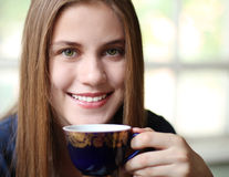 Girl with a cup of drink Stock Photography