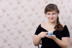 Girl with a cup in his hands. Girl with a cup in the hands of studio photography Stock Images