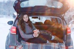 Girl with cup of hot drink at winter outside Stock Images