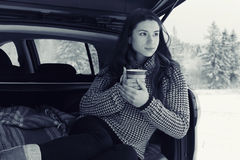 Girl with cup of hot drink at winter outside Royalty Free Stock Image