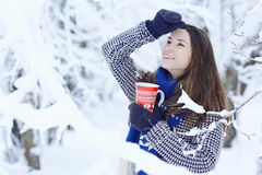 Girl  with cup of hot drink in winter park Stock Photos