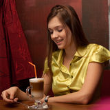 Girl with cup of latte coffee Royalty Free Stock Image