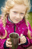 Girl and cup Stock Image