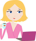 Girl with a cup look at laptop Royalty Free Stock Photos