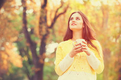Girl with cup in the park. Royalty Free Stock Image