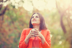 Girl with cup in the park. Royalty Free Stock Photography